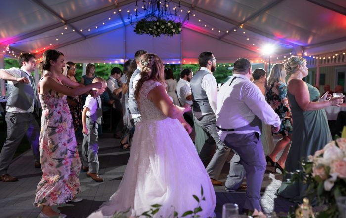 Dnncing at wedding in tented outdoor reception